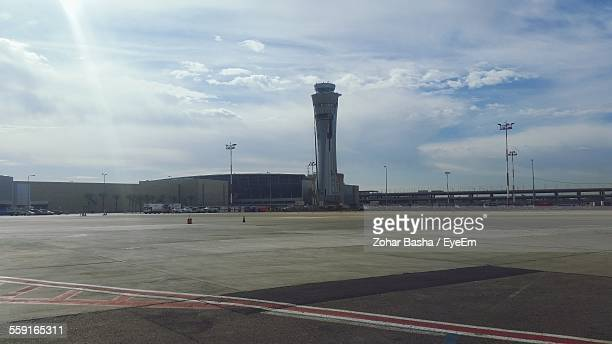 ben gurion airport against cloudy sky - ben gurion airport stock pictures, royalty-free photos & images