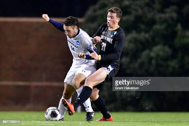 Ben Haines of Messiah College and Henrik Roesholt of North Park University compete for the ball during the Division III Men's Soccer Championship...