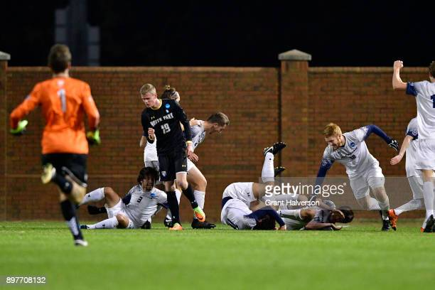 Ben Haines of Messiah College celebrates with teammates after scoring against North Park University during the Division III Men's Soccer Championship...
