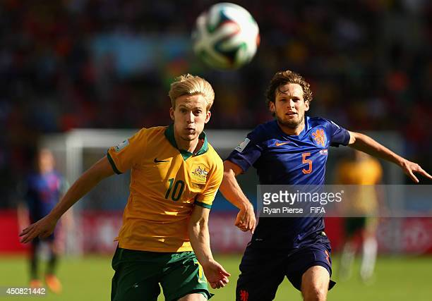 Ben Halloran of Australia competes for the ball against Daley Blind of Netherlands during the 2014 FIFA World Cup Brazil Group B match between...