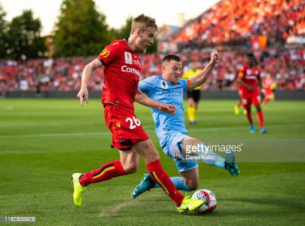 Ben Halloran of United and Scott Jamieson of Melbourne City compete for the ball during the FFA Cup Final between Adelaide United and Melbourne City...