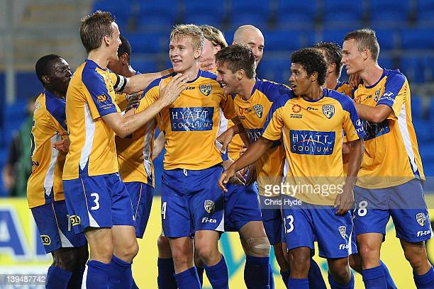 Ben Halloran of United celebrates with team mates after scoring a goal during the round 17 ALeague match between Gold Coast United and the Central...