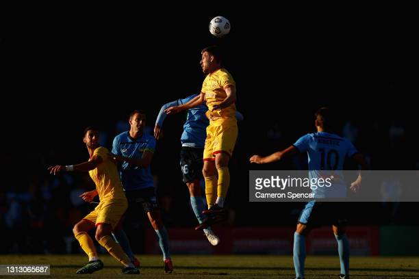 Ben Halloran of United heads the ball during the A-League match between Sydney FC and Adelaide United at Leichhardt Oval, on April 18 in Sydney,...