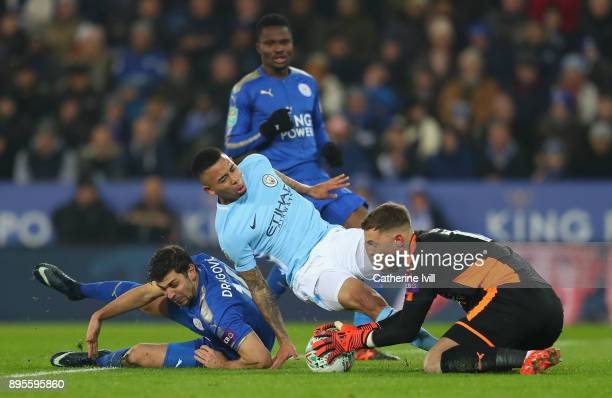 Ben Hamer and Harry Maguire of Leicester City foil Gabriel Jesus of Manchester City during the Carabao Cup QuarterFinal match between Leicester City...