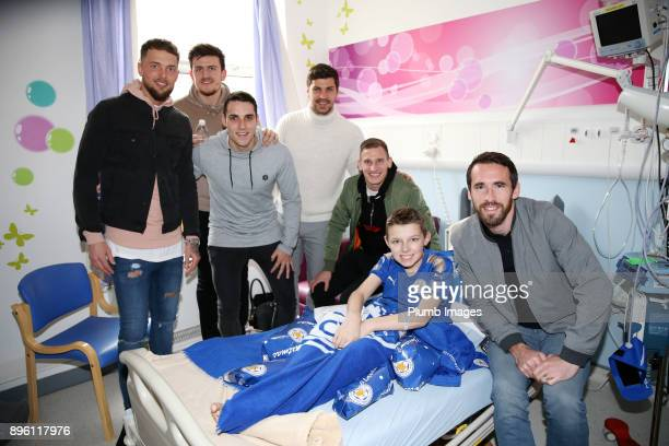 Ben Hamer Harry Maguire Matty James Aleksander Dragovic Marc Albrighton and Christian Fuchs as the Leicester City players deliver Christmas presents...