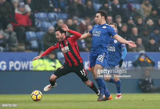 Ben Hamer of Leicester City challenge on Adam Smith of Bournemouth during the Premier League match between Leicester City and AFC Bournemouth at The...