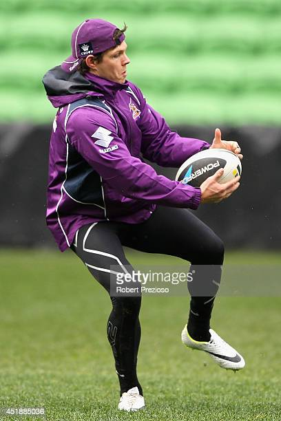 Ben Hampton gathers the ball during a Melbourne Storm NRL training session at AAMI Park on July 9 2014 in Melbourne Australia