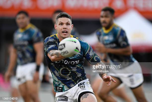 Ben Hampton of the Cowboys passes the ball during the round 12 NRL match between the North Queensland Cowboys and the Canberra Raiders at QCB Stadium...