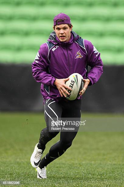 Ben Hampton runs with the ball during a Melbourne Storm NRL training session at AAMI Park on July 9 2014 in Melbourne Australia