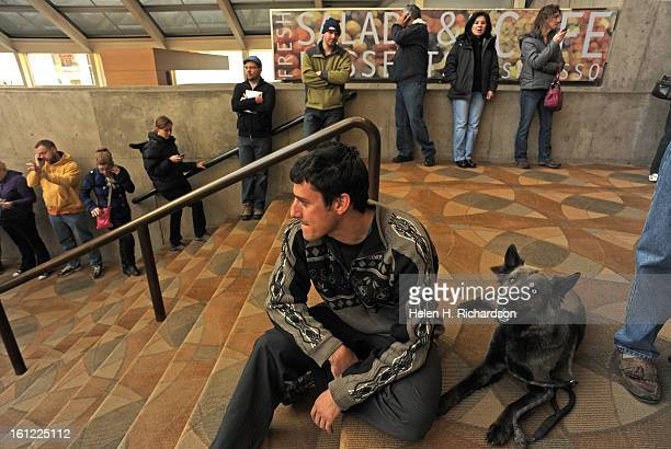Ben Handwerker and his dog Shadow wait in the long line for tickets. Single tickets for the Colorado run of The Book of MormonO went on sale at 10...