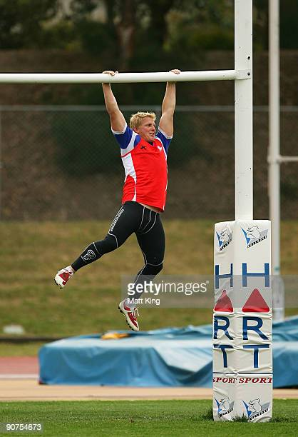 Ben Hannant hangs from the goalpost during a Bulldogs NRL training session at Sydney Olympic Park on September 15 2009 in Sydney Australia