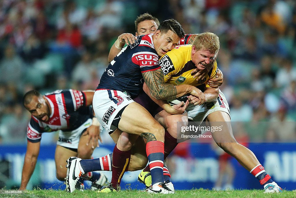 Ben Hannant of the Broncos is tackled by Sonny Bill Williams and Jared Waerea-Hargreaves of the Roosters during the round three NRL match between the Sydney Roosters and the Brisbane Broncos at Allianz Stadium on March 23, 2013 in Sydney, Australia.
