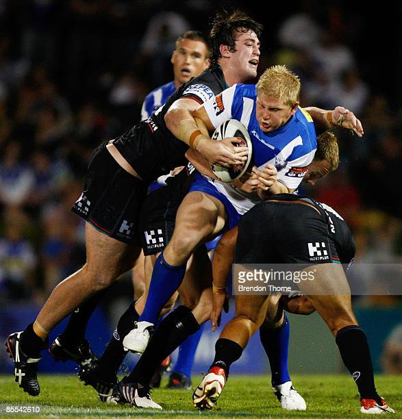 Ben Hannant of the Bulldogs is tackled by the Panthers defence during the round two NRL match between the Penrith Panthers and the Bulldogs at CUA...