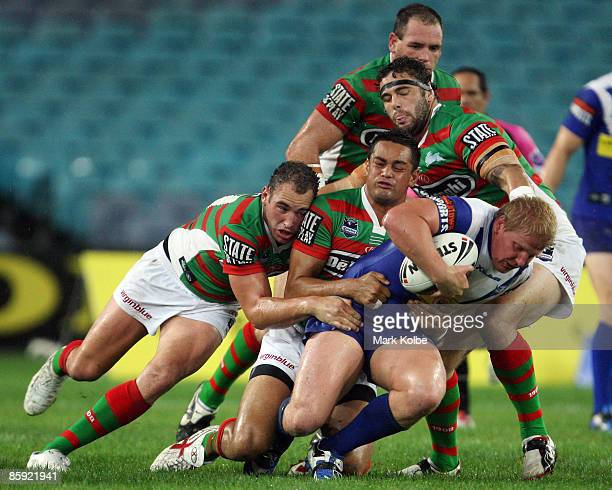 Ben Hannant of the Bulldogs is wrapped up by the Rabbitohs defence during the round five NRL match between the Bulldogs and the South Sydney...