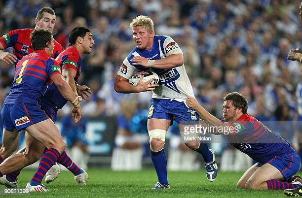 Ben Hannant of the Bulldogs makes a break during the third NRL qualifying final match between the Bulldogs and the Newcastle Knights at ANZ Stadium...