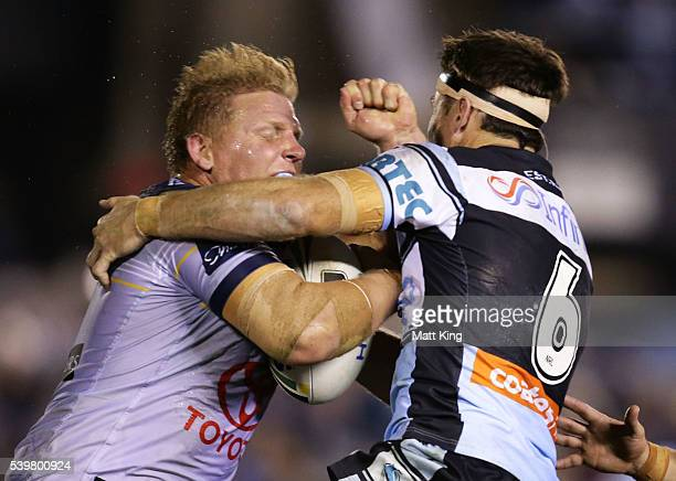 Ben Hannant of the Cowboys is tackled during the round 14 NRL match between the Cronulla Sharks and the North Queensland Cowboys at Southern Cross...