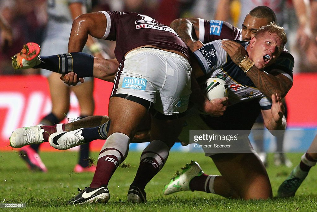 Ben Hannant of the Cowboys is tackled during the round nine NRL match between the Manly Sea Eagles and the North Queensland Cowboys at Brookvale Oval on April 30, 2016 in Sydney, Australia.