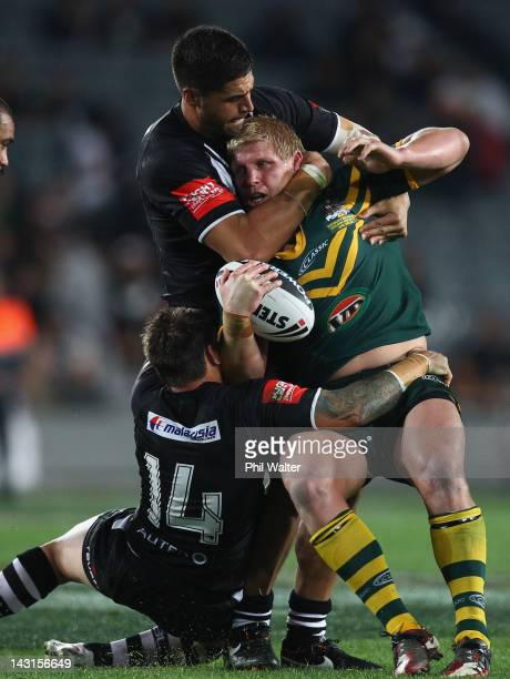 Ben Hannant of the Kangaroos is tackled by Nathan Fien and Jesse Bromwich of the Kiwis during the ANZAC Test match between the New Zealand Kiwis and...