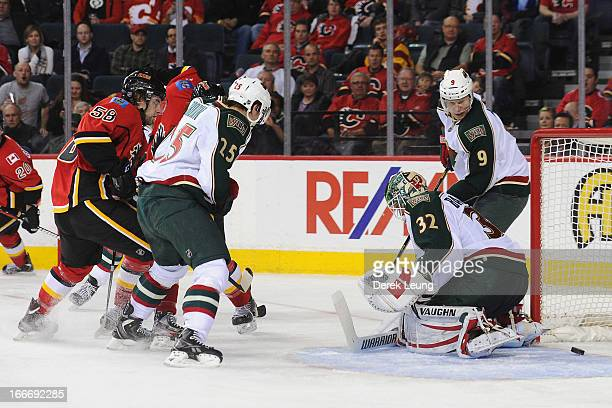 Ben Hanowski of the Calgary Flames scores his first NHL goal during a game against the Minnesota Wild at Scotiabank Saddledome on April 15 2013 in...