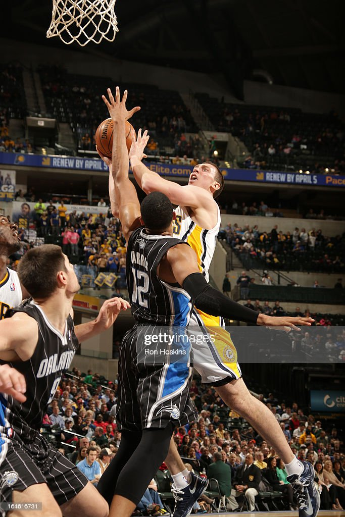 Ben Hansbrough #23 of the Indiana Pacers drives to the basket against the Orlando Magic on March 19, 2013 at Bankers Life Fieldhouse in Indianapolis, Indiana.