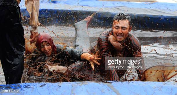Ben Hanson and Reece Dewhurst take part in the World Gravy Wrestling Championships at the Rose n Bowl Stackteads in Lancashire