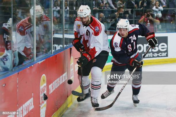 Ben Harpur of Canada and Justin Maylan of the USA compete during the Ice Hockey Classic match between the United States of America and Canada at...
