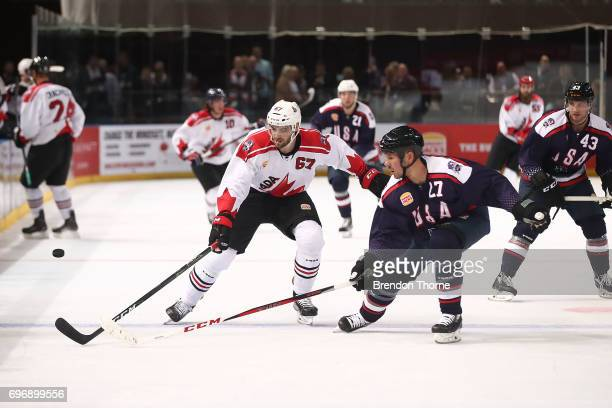 Ben Harpur of Canada competes with Scott Hannan of the USA during the Ice Hockey Classic between the United States of America and Canada at Qudos...