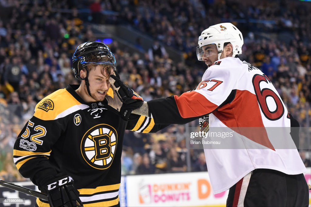 Ben Harpur #67 of the Ottawa Senators pushes his glove into the face of Sean Kurlay #52 of the Boston Bruins in Game Six of the Eastern Conference First Round during the 2017 NHL Stanley Cup Playoffs at the TD Garden on April 23, 2017 in Boston, Massachusetts.