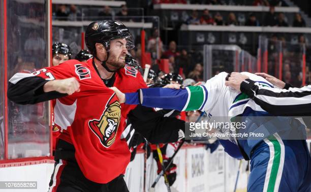 Ben Harpur of the Ottawa Senators throws a punch at Tim Schaller of the Vancouver Canucks in the first period at Canadian Tire Centre on January 2...