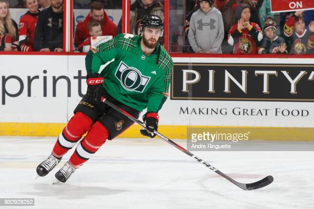 Ben Harpur of the Ottawa Senators warms up in a green jersey for St Patrick's Day prior to a game against the Dallas Stars at Canadian Tire Centre on...