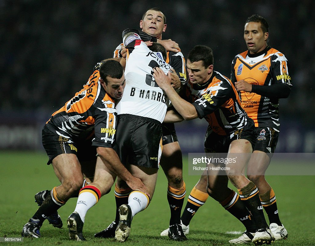 Ben Harris of Bradford hits a wall of Tigers players during the Carnegie World Club Challenge between Bradford Bulls and Wests Tigers at the Galpharm Stadium on February 03, 2006 in Huddersfield, England