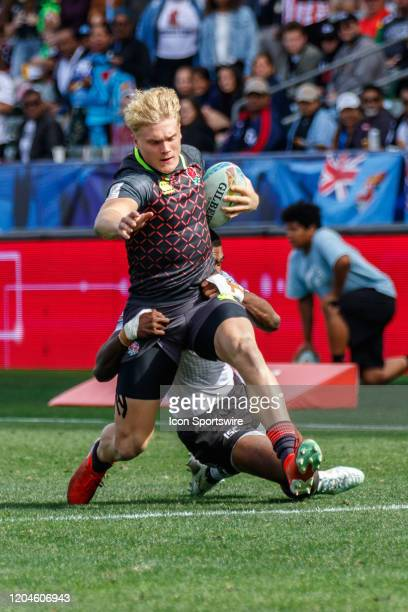 Ben Harris of England tackled by Fiji player in Match Fiji vs England during the LA Sevens Round 5 of the HSBC World Rugby Sevens Series held March 1...