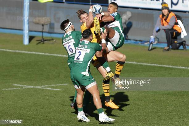 Ben Harris of Wasps Rugby and Ben Loader of London Irish jumping to catch the ball during the Gallagher Premiership match between London Irish and...
