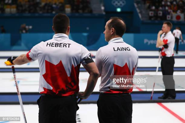 Ben Hebert Marc Kennedy and Brent Laing of Canada look on as they compete in the Curling Men's Round Robin Session 7 held at Gangneung Curling Centre...