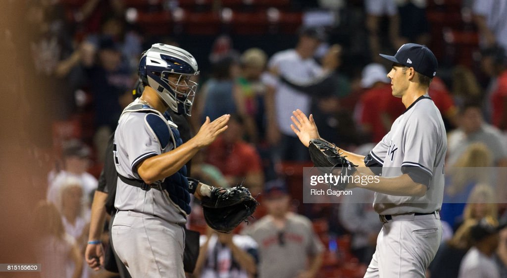 Ben Heller #41 of the New York Yankees and teammate Gary Sanchez #24 celebrate a victory against the Boston Red Sox at Fenway Park on July 15, 2017 in Boston, Massachusetts. The Yankees won 4-1 in sixteen innings.