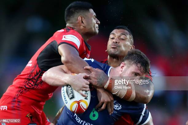 Ben Hellewell of Scotland is tackled during the 2017 Rugby League World Cup match between Scotland and Tonga at Barlow Park on October 29 2017 in...