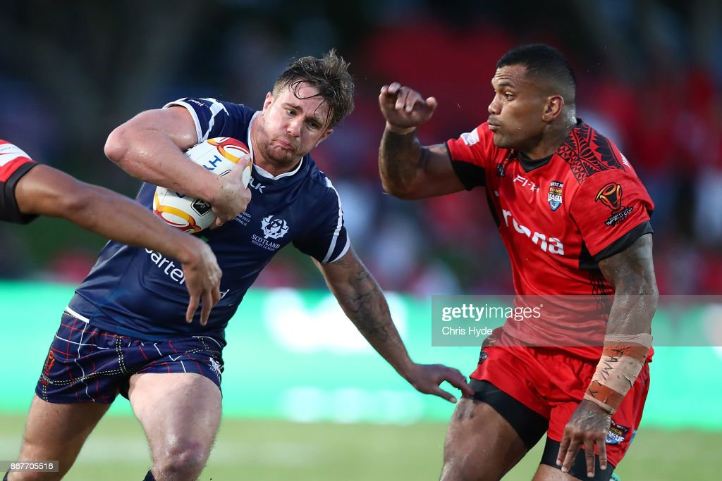 Ben Hellewell of Scotland is tackled during the 2017 Rugby League World Cup match between Scotland and Tonga at Barlow Park on October 29, 2017 in Cairns, Australia.