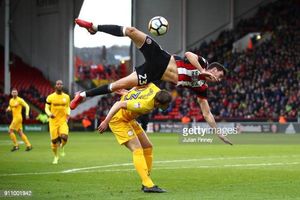 Ben Heneghan of Sheffield United collides with Paul Huntington of Preston North End during The Emirates FA Cup Fourth Round match between Sheffield...