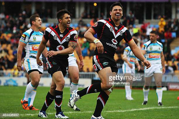 Ben Henry of the Warriors celebrates with Shaun Johnson after scoring a try during the NRL round 25 match between the New Zealand Warriors and the...
