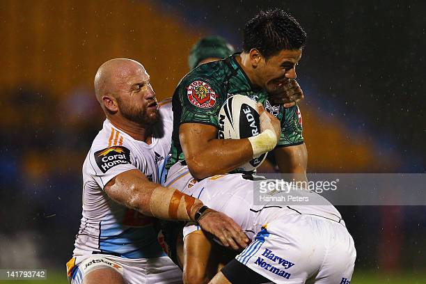 Ben Henry of the Warriors is caught by Luke Bailey of the Titans during the round four NRL match between the New Zealand Warriors and the Gold Coast...