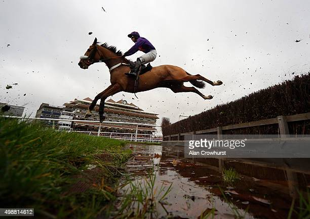 Ben Hicks riding Top Dancer clear the water jump in The Alan Mackintosh Amateur Riders' Handicap Steeple Chase at Newbury racecourse on November 26...