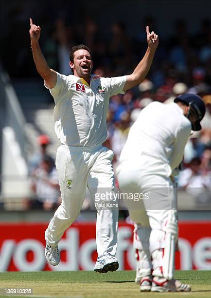 Ben Hilfenhaus of Australia celebrates dismissing Virender Sehwag of India during day one of the third Test match between Australia and India at WACA...