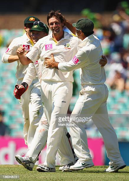 Ben Hilfenhaus of Australia celebrates with hius team mates after taking the wicket of Ravichandran Ashwin of India during day one of the Second Test...