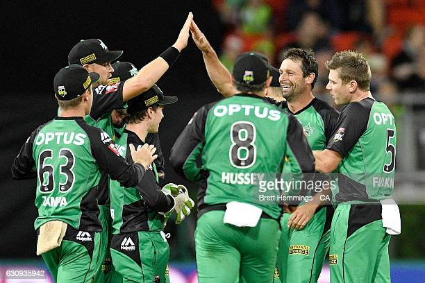 Ben Hilfenhaus of the Stars celebrates with team mates after taking the wicket of Aiden Blizzard of the Thunder during the Big Bash League match...