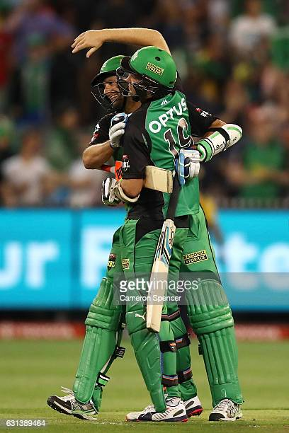 Ben Hilfenhaus of the Stars is congratulated by team mate Michael Beer after hitting the winning runs during the Big Bash League match between the...
