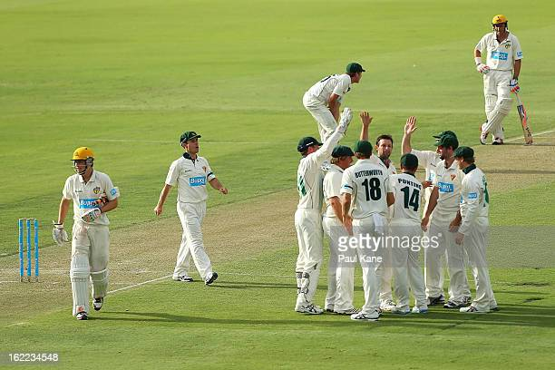 Ben Hilfenhaus of the Tigers celebrates dismissing Luke Towers of the Warriors during day one of Sheffield Shield match between the Western Australia...
