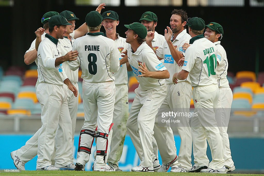 Ben Hilfenhaus of the Tigers celebrates with team mates after dismissing Ryan Harris of the Bulls during day four of the Sheffield Shield match between the Queensland Bulls and the Tasmanian Tigers at The Gabba on March 10, 2013 in Brisbane, Australia.