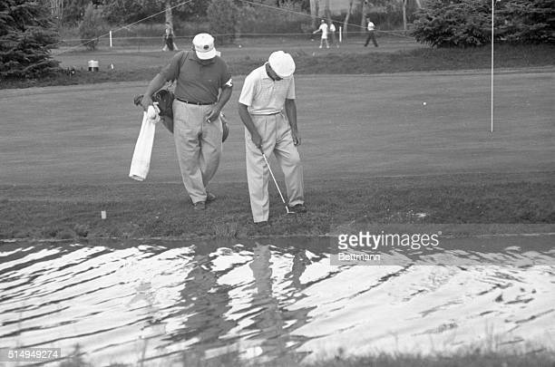 Ben Hogan who was in contention all the way in seeking his 5th US Open title met difficulty on the 17th hole on June 18 1960 Here he and his caddy...