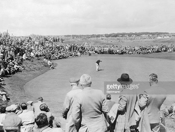 Ben Hogan winner of the British Open Golf Championship is shown putting on No2 green during his game with Ugo Grappasoni of Italy Hogan rallied with...