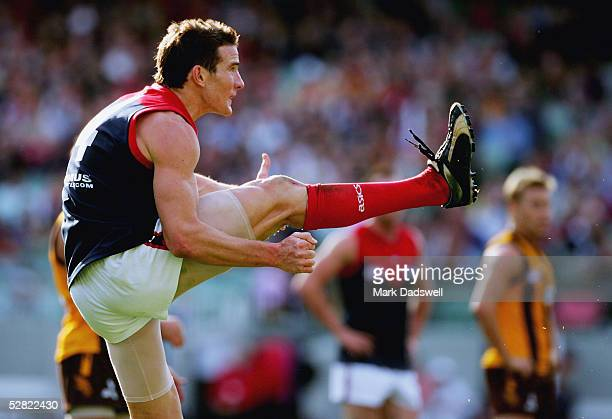 Ben Holland for the Demons kicks for goal during the AFL Round 8 match between the Hawthorn Hawks and the Melbourne Demons at the MCG May 14, 2005 in...